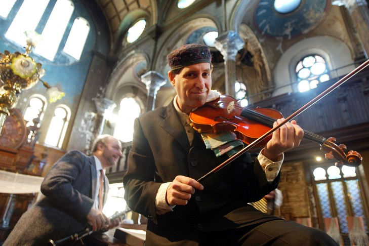 A klezmer band warms up before Barry and Hilit Edelstein's wedding in the historic Eldridge Street Synagogue in Manhattan's lower east side neighborhood. (Photo by Mario Tama/Getty Images)