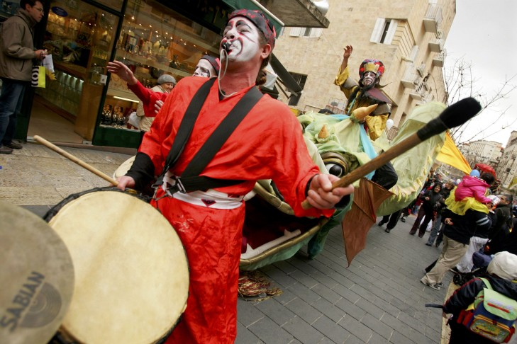 Israeli's celebrate the Jewish festival of Purim in Jerusalem.  (Photo by Paula Bronstein/Getty Images)