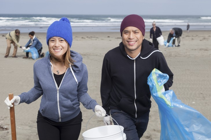 Group of volunteers help clean up a public beach (Photo: Jason Doiy/iStock)