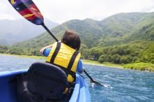 Boy kayaking at summer camp (Photo: GOTO_TOKYO/iStock)