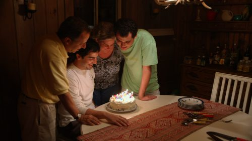 The Suskind family celebrating a birthday