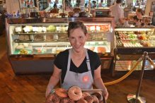 With the deli and restaurant as a backdrop, Mamaleh's Pastry Chef and partner Rachel Sundet presents some fresh made bagels and bialys. (Credit: Chris Christo)