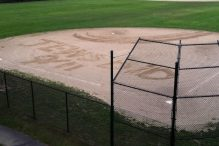"The message ""Jews did 9/11"" was inscribed in the dirt of the softball field at Marblehead High School last week. (MARBLEHEAD POLICE)"