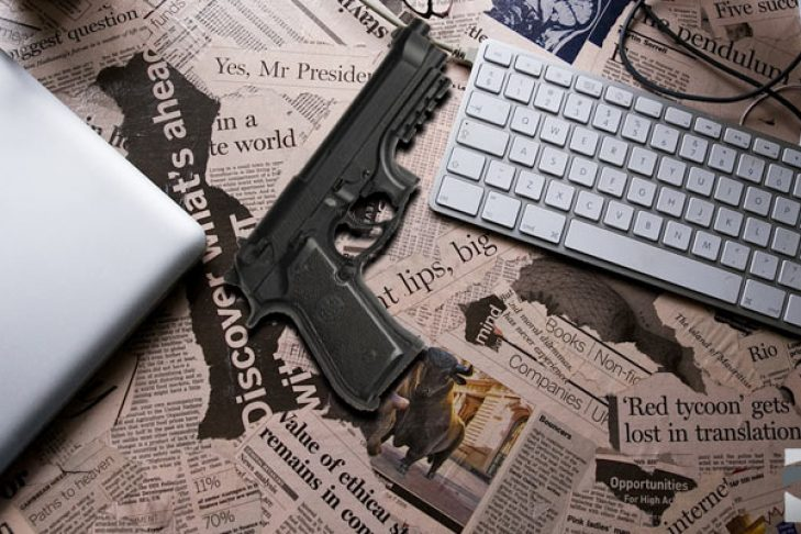 desk-newspaper-headlines-gun-770x400