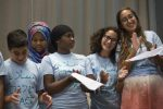 Several of the teens involved in the Kids4Peace Boston program gave a presentation at Temple Beth Avodah in Newton about their peace-building experiences. (DINA RUDICK/GLOBE STAFF)