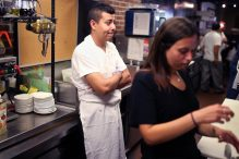 Rubin's employee Henry Sanchez took a moment to take in the scene on what may have been the deli's last day in business after nearly 90 years. (JONATHAN WIGGS/GLOBE STAFF)