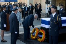 Israeli Prime Minister Benjamin Netanyahu places a wreath by the coffin of former Israeli President Shimon Peres at the Knesset, Israel's Parliament, in Jerusalem, Thursday, Sept. 29, 2016. Peres died early Wednesday from complications from a stroke. He was 93. (AP Photo/Ariel Schalit)