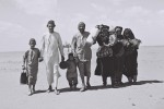 "A YEMENITE FAMILY WALKING THROUGH THE DESERT TO   A RECEPTION CAMP SET UP BY THE ""JOINT"" NEAR ADEN.