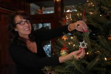 Randy O'Brien of Sharon placed a Star of David on the Christmas tree. (BARRY CHIN/GLOBE STAFF)