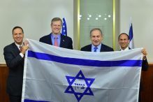 Prime Minister Benjamin Netanyahu was presented with a replica of the 1891 Israeli flag by Massachusetts Governor Charlie Baker