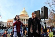 Rabbi Shoshana Meira Friedman, left, sings with the Rev. Mariama White-Hammond at the Massachusetts State House. (Courtesy Hebrew College)