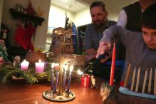 Karolyn Feeks Maws and Tony Maws are raising Charlie, 8, in Jewish and Christian traditions. (PAT GREENHOUSE/GLOBE STAFF)