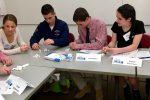 Emily Drucker, Josh Feinstein, Sam Klein Roche, and Rachel Silverman working on a team-building exercise.