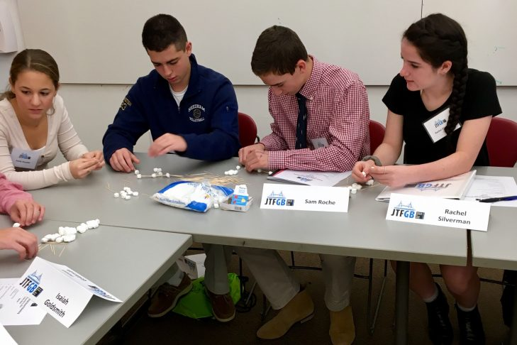 Emily Drucker, Josh Feinstein, Sam Klein Roche, and Rachel Silverman working on a team-building exercise.