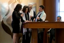 Zoe Spiegel was joined by her parents at her bat mitzvah at Temple Beth Shalom. (JONATHAN WIGGS /GLOBE STAFF)