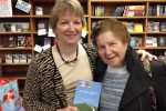 Author Jill Ebstein, left, at a book signing (Photo: New England Mobile Book Fair)