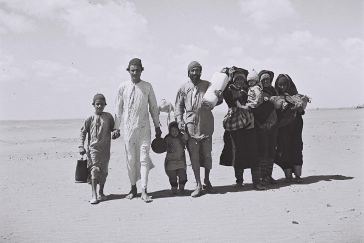 "A YEMENITE FAMILY WALKING THROUGH THE DESERT TO A RECEPTION CAMP SET UP BY THE ""JOINT"" NEAR ADEN."