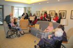 Residents at the Leonard Florence Center are visited by students in the girl's choir from Chelsea High School