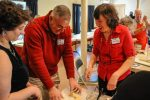Bedford Police Chief Robert Bongiorno shaped his challah with the help of Rabbi Susan Abramson during a challah bread making lesson at the First Church of Christ in Bedford. Photo: James Jesson/File