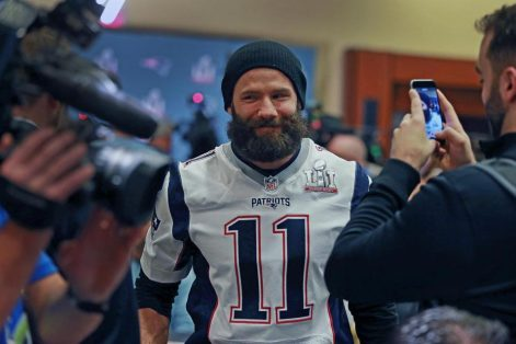 Patriots wide receiver Julian Edelman flashed a smile at a New England media availability in Houston. (JIM DAVIS/GLOBE STAFF)