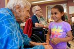 A senior at Hebrew Rehabilitation Center in Roslindale interacts with a local preschool student. (Courtesy Hebrew SeniorLife)