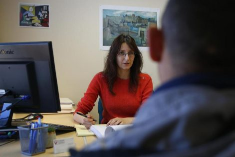 Mariam Liberles, an immigration lawyer and supervising attorney at Catholic Charities' Immigration Legal Services, met with a client at her office. (JESSICA RINALDI/GLOBE STAFF)