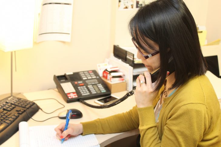 Immigration Legal Services staff attorney Jill K. Hwang working in her office. (Courtesy Catholic Charities)