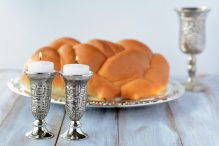 Shabbat candles with Challah bread and wine cup
