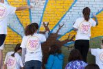 Here comes the sun! Teens paint a 10x10-foot mural at a local homeless shelter. (Courtesy Jewish Teen Initiative)