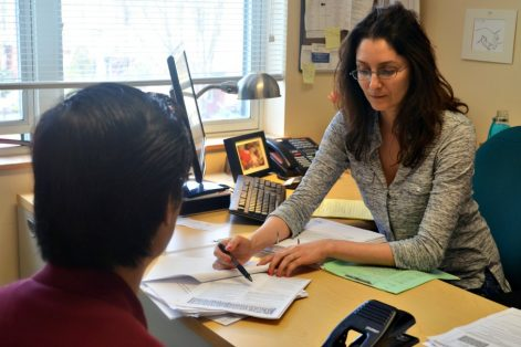 Immigration Legal Services supervising attorney Mariam Liberles working with a client. (Courtesy Catholic Charities)