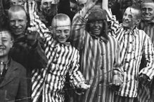 "The documentary ""Etched in Glass The Legacy of Steve Ross"" shows Ross (third from left), a Holocaust survivor, at Dachau, one of the Nazis' concentration camps."