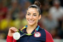 Aly Raisman celebrates on the podium after winning a silver medal at the Rio Olympic Arena, Aug. 16, 2016. (Alex Livesey/Getty Images)