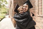 Women celebrate graduating (photo: Lorraine Boogich/iStock)