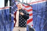 The fantastic Jon Stewart with a microphone in his left hand. (Photo: Cliff/Flickr)