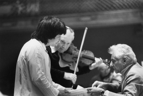 BSO artistic director and conductor Seiji Ozawa, violinist Isaac Sternand Leonard Bernstein confer during a rehearsal at Boston's Symphony Hall around 1980 (Florence Y. Montgomery/Courtesy BSO Archives)