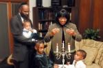 The McCoy family observing Shabbat (Photo: Jayne Guberman/Flickr)