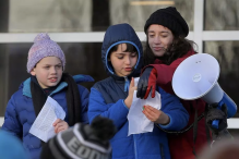 Henry Greenwold (left), Eli Setiya, and teacher Mirah Sand addressed the protest crowd on Sunday at the Suffolk County House of Correction in South Bay, which houses a detention center run by US Immigration and Customs Enforcement. (PAT GREENHOUSE/GLOBE STAFF)
