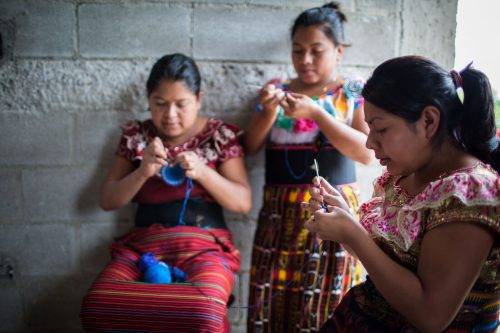 Women from San Pablo crocheting the kippot