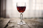 Red wine in glass on a rustic table