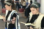 Rabbinical students at Hebrew College near Boston, including Gita Karasov, left, are creating a video that shows women, transgender and non-binary Jews demonstrating how to wear tefillin. (Dena Trugman)