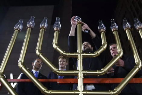 REFERRAL: Rabbi Rachmiel Liberman of Congregation Lubavitch Synagogue was joined by Israel's consul general Yehuda Yaakov, Rep. Joe Kennedy, and Mayor Marty Walsh while lighting a giant menorah in Downtown Crossing on Dec. 6, 2015.