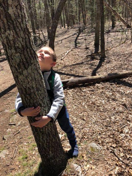 Elijah hugging tree
