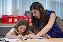 Teacher Marla Quinn works with student Danya (Photo: Heidi Aaronson)