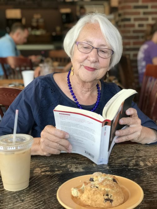 Janet Freedman, book and a summer iced coffee at Kickstand. Freedman, a resident Scholar and Brandeis University's Womens Studies Research Center, is a cafe regular, with her husband, Andrew Peppard. (Photo: Andrew Peppard)