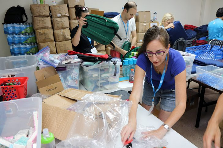 Kimberlee Schumacher packs backpacks for asylum seekers to support the Interfaith Welcome Coalition. (Photo: Craig Byer/CJP)