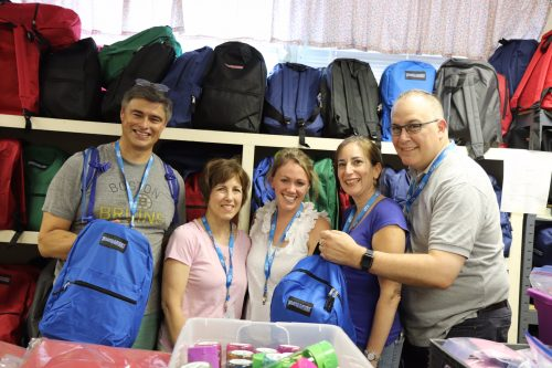 From left: Lino Covarrubias, Karin Blum, Sarah Abramson, Kimberlee Schumacher and Jeremy Burton with backpacks full of supplies for asylum seekers. (Photo: Craig Byer/CJP)