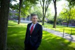 The 29th Harvard University president, Larry Bacow, walks through Harvard Yard on his first day in office. (Rose Lincoln/Harvard Staff Photographer)