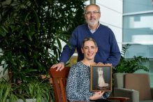 REFERRAL USE ONLY Lauren Corduck and her father, Bob Cooperstein, have the BRCA1 gene mutation. She holds a photo of her grandmother, Frances, who died at 56 from breast cancer. (Photo: Sarah Bastille for Massachusetts General Hospital Cancer Center)