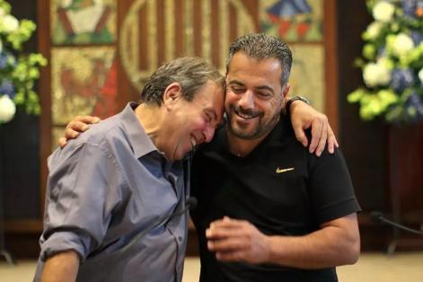 REFERRAL: Rami Elhanan (left) and Mazen Faraj hugged Saturday in Boston. (JOHN TLUMACKI/GLOBE STAFF)
