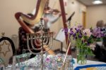 A menorah and music at the Family Table Chanukkah Celebration